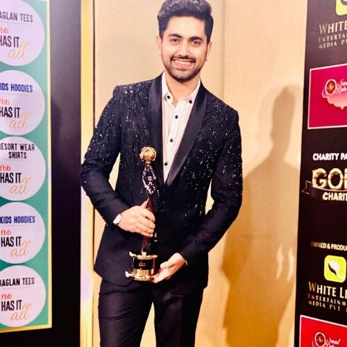 Zain with award