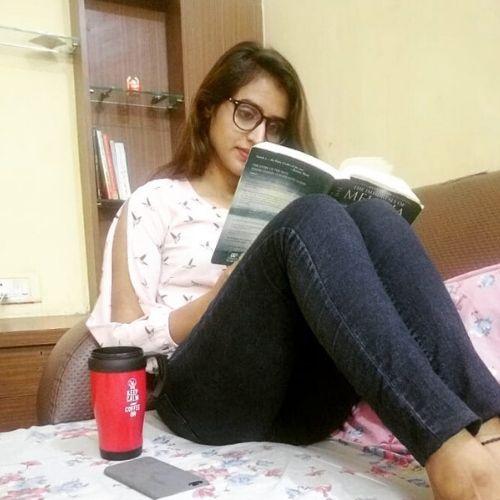 Shiva reading book